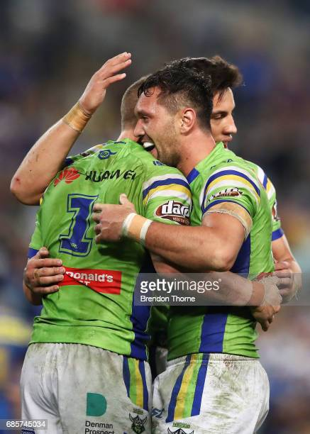 Jack Wighton of the Raiders celerates with team mate Jordan Rapana after a try saving tackle against the Eels at full time during the round 11 NRL...
