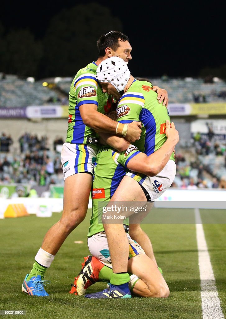 Jack Wighton of the Raiders is congratulated by team mates after scoring a late try during the round 12 NRL match between the Canberra Raiders and the Manly Sea Eagles at GIO Stadium on May 25, 2018 in Canberra, Australia.