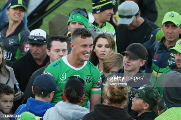 Jack Wighton of the Raiders is mobbed by fans after the round eight NRL match between the Canberra Raiders and the Penrith Panthers at McDonalds Park...
