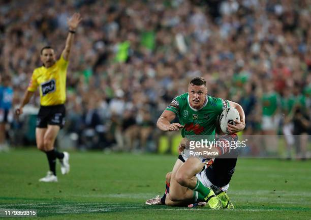 Jack Wighton of the Raiders is tackled as Referee Gerard Sutton signals last tackle during the 2019 NRL Grand Final match between the Canberra...