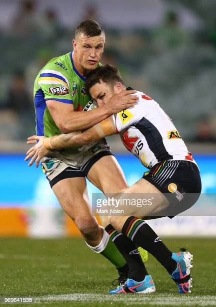 Jack Wighton of the Raiders is tackled by James Maloney of the Panthers during the round 14 NRL match between the Canberra Raiders and the Penrith...
