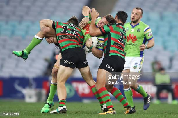 Jack Wighton of the Raiders is tackled by the Rabbitohs defence during the round 21 NRL match between the South Sydney Rabbitohs and the Canberra...