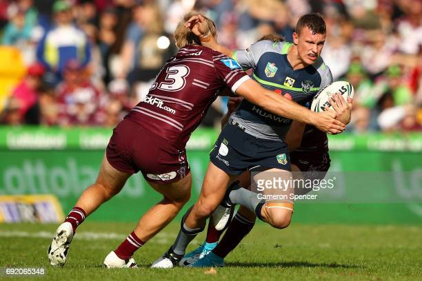 Jack Wighton of the Raiders is tackled during the round 13 NRL match between the Manly Sea Eagles and the Canberra Raiders at Lottoland on June 4...