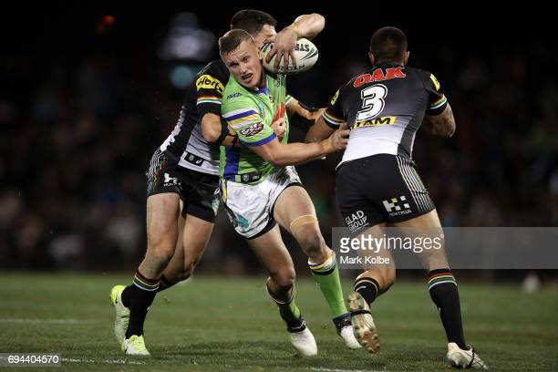 Jack Wighton of the Raiders is tackled during the round 14 NRL match between the Penrith Panthers and the Canberra Raiders at Carrington Park on June...