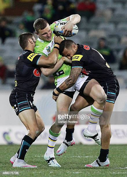 Jack Wighton of the Raiders is tackled during the round 25 NRL match between the Canberra Raiders and the Penrith Panthers at GIO Stadium on August...