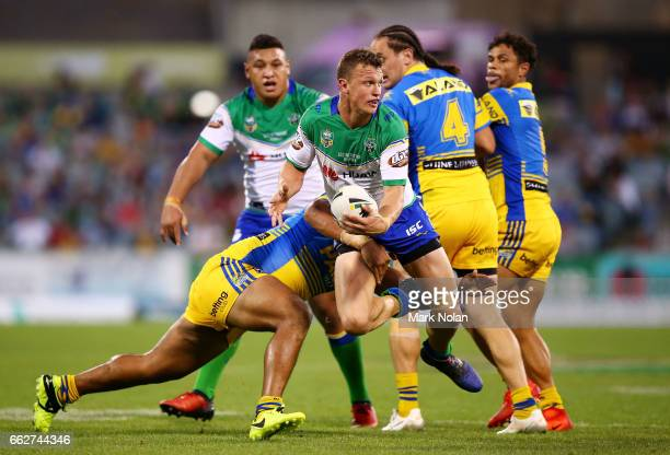 Jack Wighton of the Raiders looks to offload during the round five NRL match between the Canberra Raiders and the Parramatta Eels at GIO Stadium on...