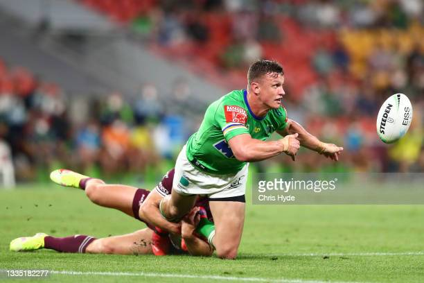 Jack Wighton of the Raiders offloads during the round 23 NRL match between the Canberra Raiders and the Manly Sea Eagles at Suncorp Stadium, on...