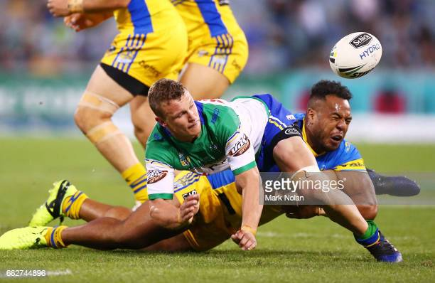 Jack Wighton of the Raiders offloads during the round five NRL match between the Canberra Raiders and the Parramatta Eels at GIO Stadium on April 1...