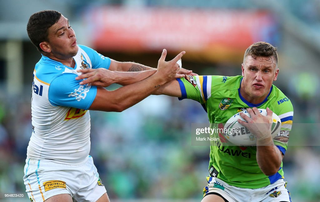 Jack Wighton of the Raiders palms off the defence during the round nine NRL match between the Canberra Raiders and the Gold Coast Titans at GIO Stadium on May 5, 2018 in Canberra, Australia.