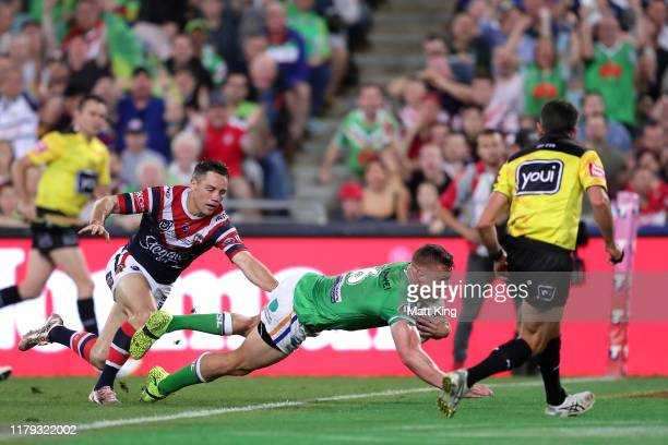 Jack Wighton of the Raiders scores a try during the 2019 NRL Grand Final match between the Canberra Raiders and the Sydney Roosters at ANZ Stadium on...