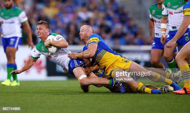 Jack Wighton of the Raidersis tackled during the round five NRL match between the Canberra Raiders and the Parramatta Eels at GIO Stadium on April 1...