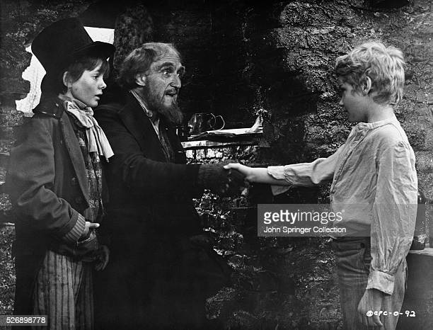 Jack Wild as The Artful Dodger Ron Moody as Fagin and Mark Lester as Oliver Twist in the 1968 musical Oliver