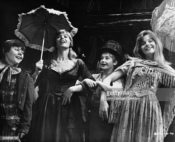 Jack Wild as The Artful Dodger Shani Wallis as Nancy and Mark Lester as Oliver Twist join another singer in the 1968 musical Oliver