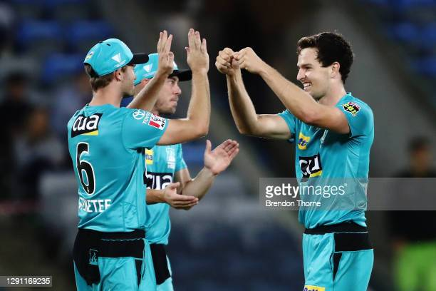 Jack Wildermuth of the Heat celebrates with team mates after claiming the wicket of Callum Ferguson of the Thunder during the Big Bash League match...