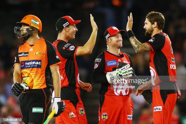Jack Wildermuth Tim Ludeman and Kane Richardson of the Renegades celebrate the wicket of Andrew Tye of the Scorchers during the Big Bash League match...