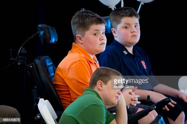 Jack Willis center Nolan Willis right and Max LeClairebottom are all afflicted with Duchenne muscular dystrophy They attended the opening for Sarepta...