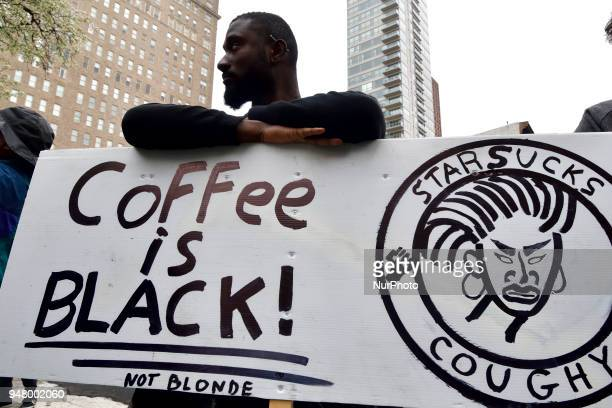 Jack Willis leans on a sign that reads Coffee Is Black as protesters gather at the Starbucks location in Center City Philadelphia PA on April 15 2018...