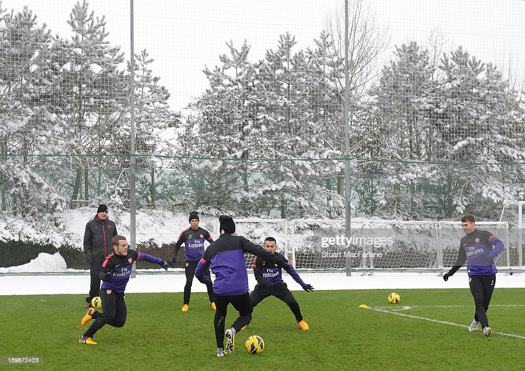 Jack Wilshere, Alex Oxlade-Chamberlain, Carl Jenkinson, Nico Yennaris and Aaron Ramsey of Arsenal in action during a training session at London Colney on January 22, 2013 in St Albans, England.