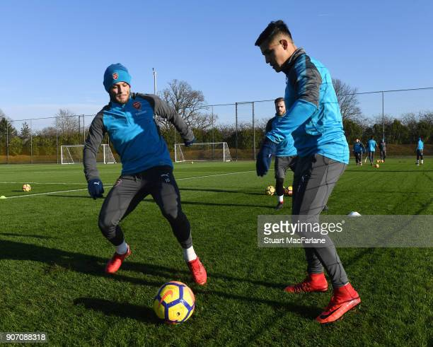 Jack Wilshere and Alexis Sanchez of Arsenal during a training session at London Colney on January 19 2018 in St Albans England