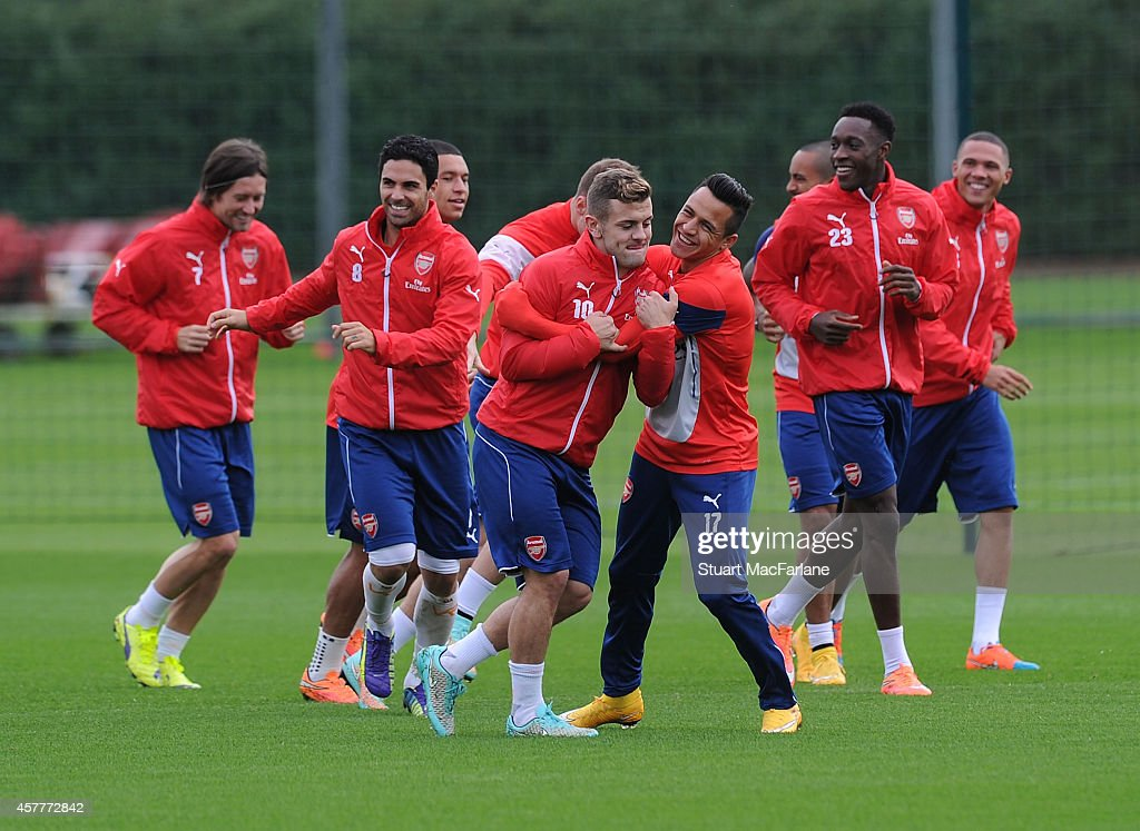 Jack Wilshere and Alexis Sanchez of Arsenal joke around during a training session at London Colney on October 24, 2014 in St Albans, England.