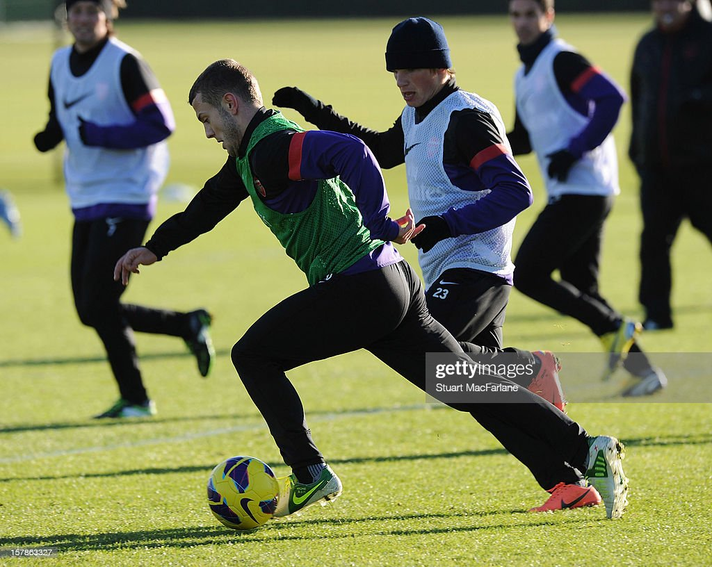 Jack Wilshere and Andrey Arshavin of Arsenal during a training session at London Colney on December 07, 2012 in St Albans, England.
