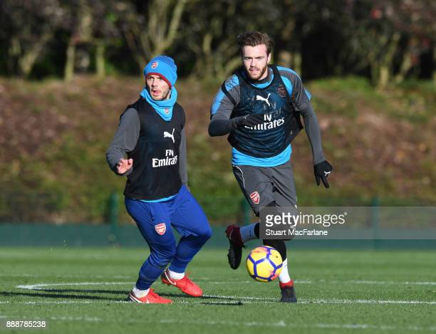Jack Wilshere and Calyum Chambers of Arsenal during a training session at London Colney on December 9 2017 in St Albans England