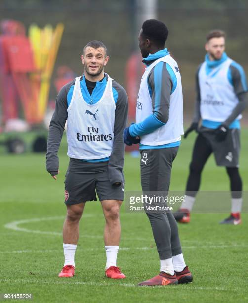 Jack Wilshere and Danny Welbeck of Arsenal during a training session at London Colney on January 13 2018 in St Albans England