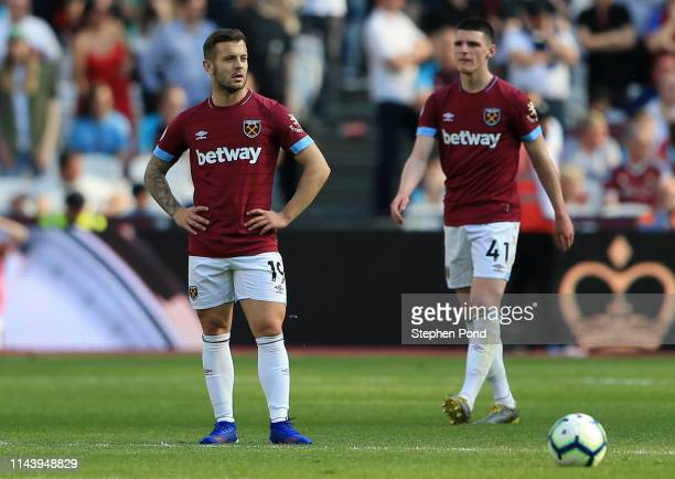Jack Wilshere and Declan Rice of West Ham United look on during the Premier League match between West Ham United and Leicester City at London Stadium...