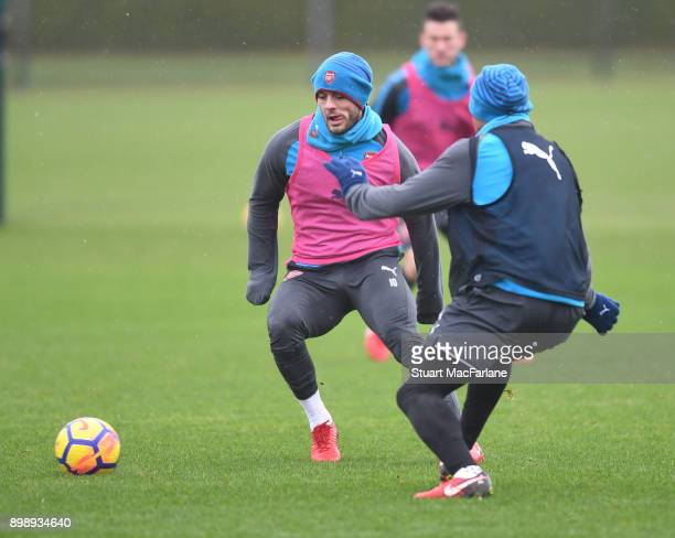 Jack Wilshere and Francis Coquelin of Arsenal during a training session at London Colney on December 27 2017 in St Albans England