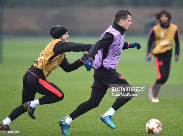 Jack Wilshere and Granit Xhaka of Arsenal during a training session at London Colney on February 21 2018 in St Albans England
