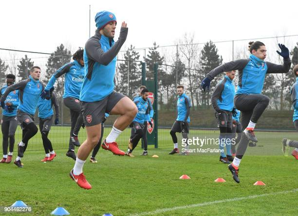 Jack Wilshere and Hector Bellein of Arsenal during a training session at London Colney on January 13 2018 in St Albans England