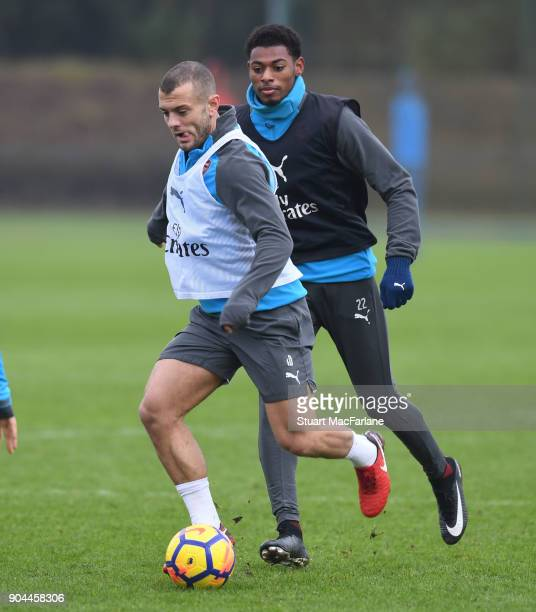 Jack Wilshere and Jeff ReineAdelaide of Arsenal during a training session at London Colney on January 13 2018 in St Albans England