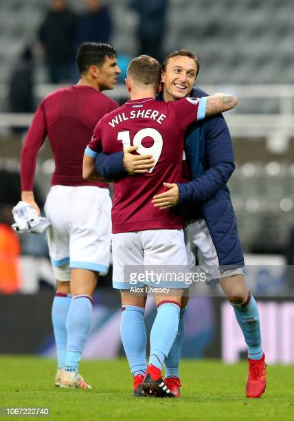 Jack Wilshere and Mark Noble of West Ham United celebrate victory following the Premier League match between Newcastle United and West Ham United at...