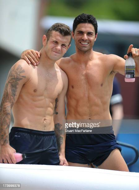 Jack Wilshere and Mikel Arteta of Arsenal during a training session at the Mizunho Park Rugby Stadium on July 19 2013 in Nagoya Japan