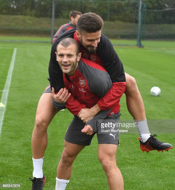 Jack Wilshere and Olivier Giroud of Arsenal during a training session at London Colney on October 23 2017 in St Albans England