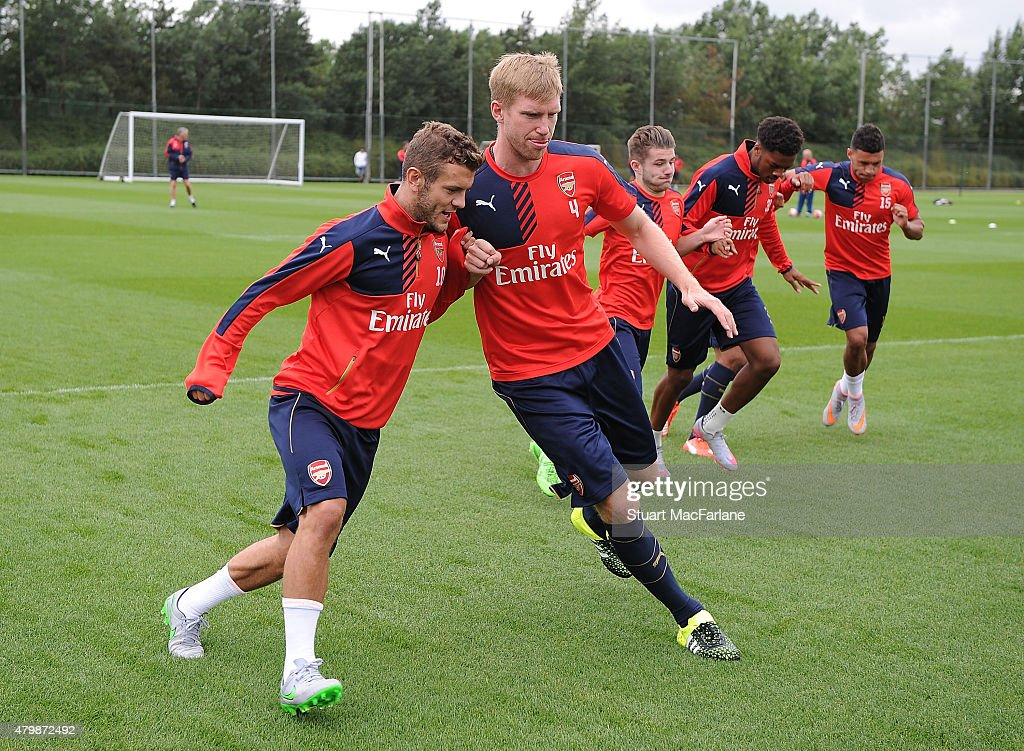 Jack Wilshere and Per Mertesacker of Arsenal during a training session at London Colney on July 8, 2015 in St Albans, England.
