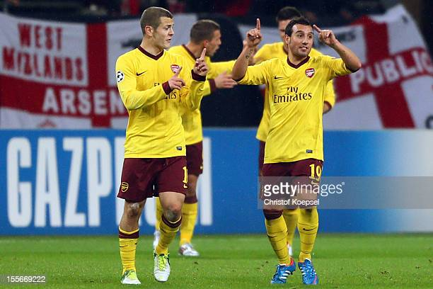 Jack Wilshere and Santi Cazorla of Arsenal celebrate the second goal during the UEFA Champions League group B match between FC Schalke 04 and Arsenal...