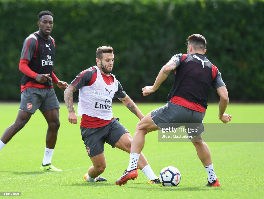 Jack Wilshere and Sead Kolasinac of Arsenal during a training session at London Colney on August 24, 2017 in St Albans, England.