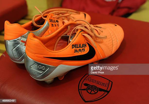 Jack Wilshere boots sit in the changing room before the match between Arsenal and Manchester United in the Barclays Premier League at Emirates...