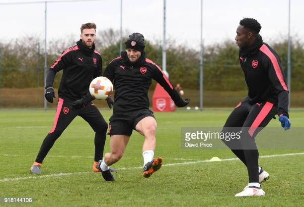 Jack Wilshere Calum Chamber and Danny Welbeck of Arsenal during the Arsenal training session at London Colney on February 14 2018 in St Albans England
