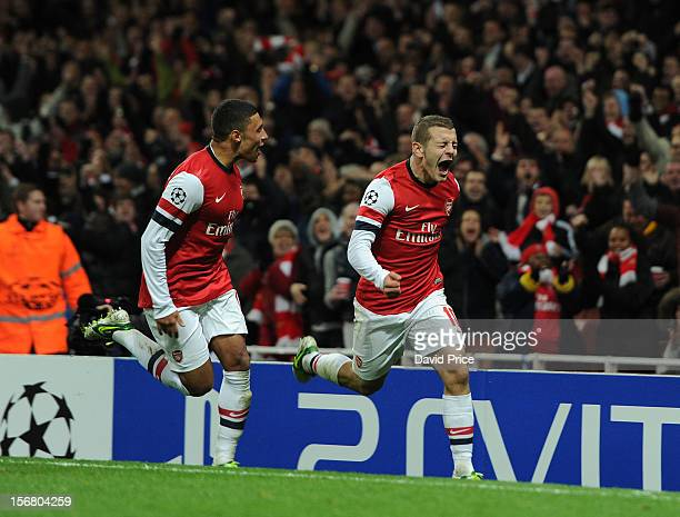Jack Wilshere celebrates scoring Arsenal's 1st goal with Alex OxladeChamberlain of Arsenal during the UEFA Champions League Group B match between...