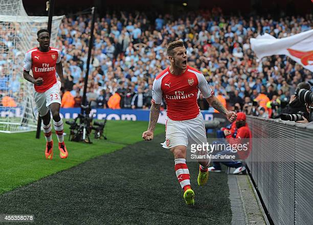 Jack Wilshere celebrates scoring for Arsenal during the Barclays Premier League match between Arsenal and Manchester City at Emirates Stadium on...
