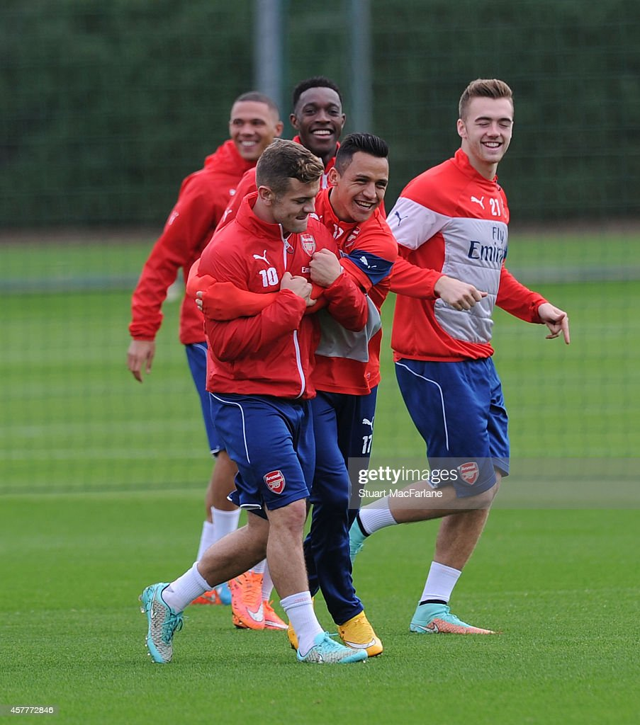 Jack Wilshere, Danny Welbeck, Alexis Sanchez and Calum Chambers of Arsenal attends a training session at London Colney on October 24, 2014 in St Albans, England.