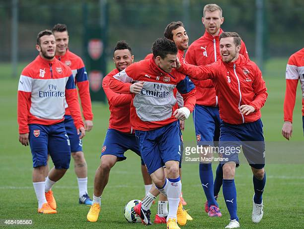 Jack Wilshere, Francis Coquelin, Laurent Koscielny and Aaron Ramsey of Arsenal during a training session at London Colney on April 3, 2015 in St...