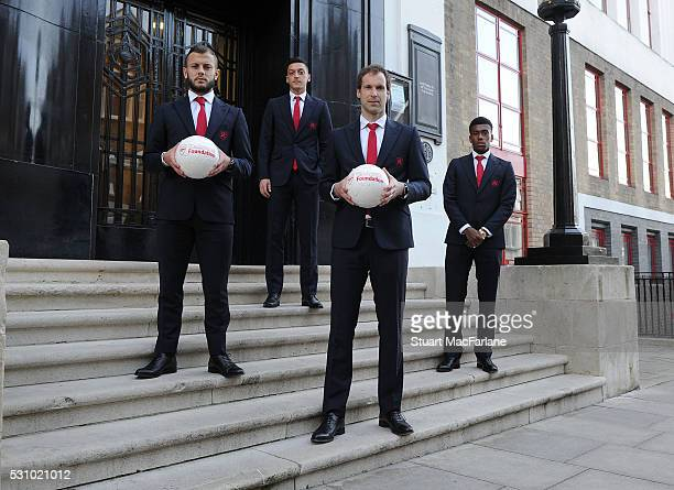 Jack Wilshere, Mesut Ozil, Petr Cech and Alex Iwobi of Arsenal at the old Arsenal Stadium before attending the Arsenal Foundation Ball at Emirates...