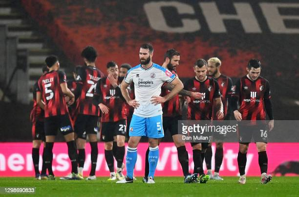 Jack Wilshere of AFC Bournemouth celebrates with his team mates after scoring their team's first goal as Joe McNerney of Crawley Town reacts during...