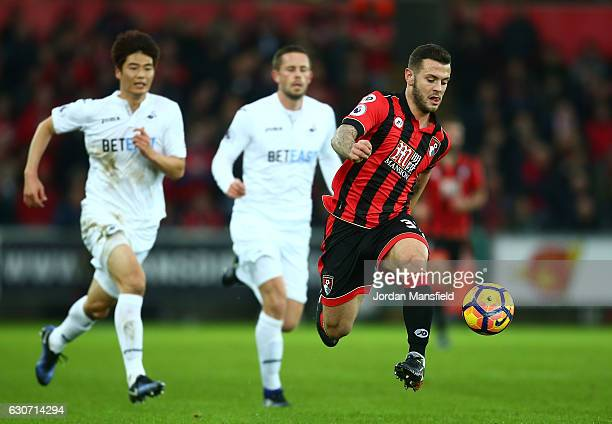 Jack Wilshere of AFC Bournemouth controls the ball during the Premier League match between Swansea City and AFC Bournemouth at Liberty Stadium on...