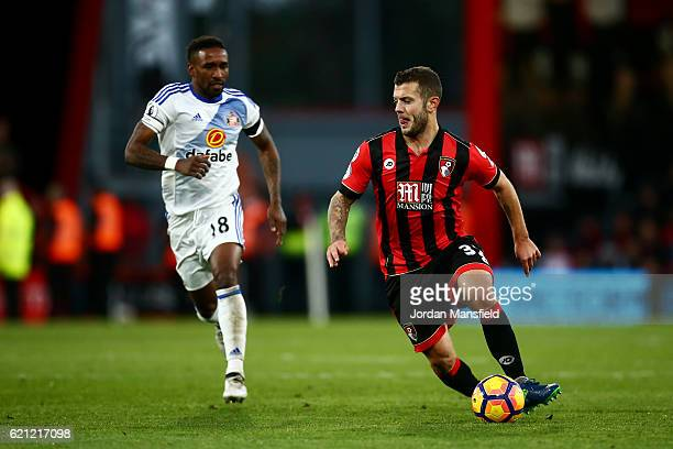 Jack Wilshere of AFC Bournemouth is chased down by Jermain Defoe of Sunderland during the Premier League match between AFC Bournemouth and Sunderland...