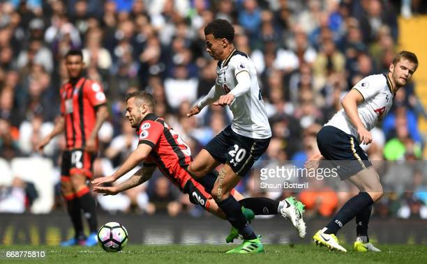 Jack Wilshere of AFC Bournemouth is tackled by Dele Alli of Tottenham Hotspur during the Premier League match between Tottenham Hotspur and AFC...