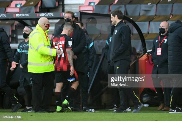Jack Wilshere of AFC Bournemouth leaves the pitch after receiving a second yellow and therefore a red card during the Sky Bet Championship match...